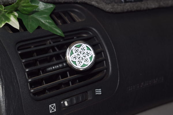 Essential oil diffuser clipped on to a car vent