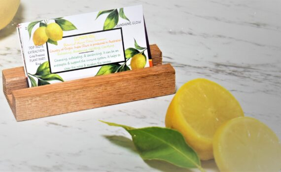 """A """"lemon essential oil collector card"""" in card holder"""
