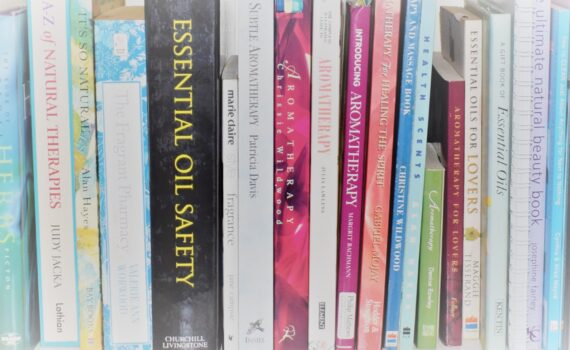 A shelf of aromatherapy and essential oil safety books