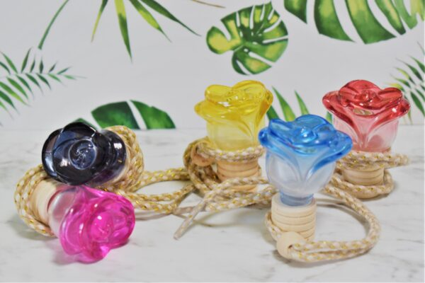 five colourful glass rose bottles