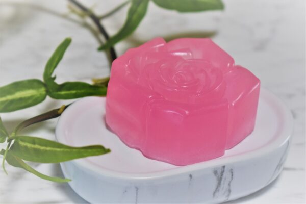 A pink soap in the shape of a rose